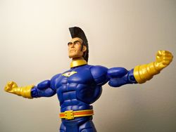 Omac-arms-outstretched.jpg
