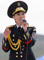 Mongolian female soldier is singing.png