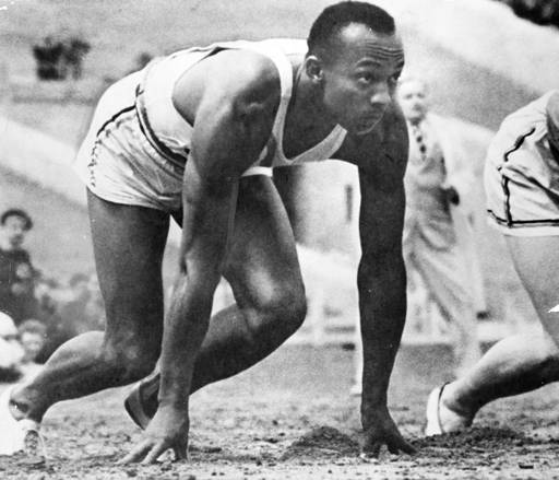 Olympic-sprinter-Jesse-Owens-awaits-the-start-of-a-race-at-the-1936-Olympic-Games-in-Germany..jpg