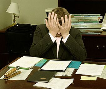Frustrated man at a desk (cropped).jpg