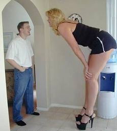 A typical Amazon Woman towering above a man above 6 foot.